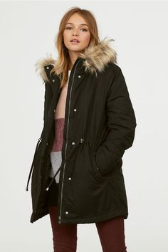 Padded parka in woven fabric with a pile-lined hood with detachable faux fur trim. Zip and wind flap at front with snap fasteners, semi-attached yoke at bac Black Parka Jacket, Fur Jacket, Green Parka, Parka Outfit, Mens Winter Coat, Winter Coats, Winter Jackets, Pants For Women, Jackets For Women