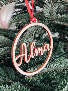 Christmas Bauble Personlised with Name. Hanging Christmas Tree Decoration. Laser Engraved Wooden Bauble. Personalised Xmas Decoration. Tree by InspiredbyAlma on Etsy Hanging Christmas Tree, Christmas Wood, Xmas Tree, Christmas Gifts, Christmas Ornaments, Personalised Christmas Baubles, Christmas Napkins, Christmas Party Decorations, Festival Decorations