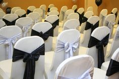 Who needs colour?! Alternating black and silver taffeta chair sashes on lycra chair covers are contemporary and stylish.