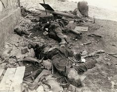 Last fight: Three dead German Waffen-SS Troops lie on the ground
