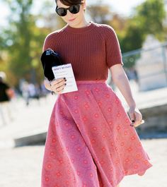 Warm colors vibrate off of this knit and a-line skirt. // Photo: The Stylograph #PFW #streetstyle