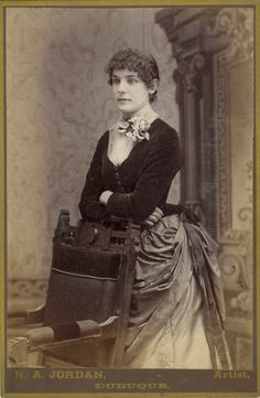 This photography shows a Victorian lady in an amazing dress. It was taken 1884 or 1885.