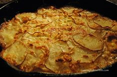"""Thinly sliced potatoes mixed with gruyere and feta cheese form the crust for this amazing """"upside down"""" tart. The sweetness of caramelized red onion is balanced perfectly against the sh… Cheese Potatoes, Sliced Potatoes, Onion Tart, Potato Onion, Savory Tart, Vegetable Sides, Vegetarian Cheese, Caramelized Onions, Other Recipes"""