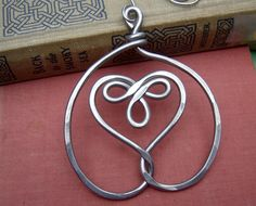 Celtic Embraced Heart Ornament - Light Weight Aluminum Wire - Christmas Ornament. $15.50, via Etsy.