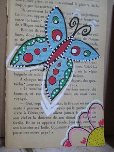 vieux livres de poche recyclés, dessin posca sur page de livre                                                                                                                                                                                 Plus