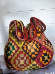 2012_02_05_16.Another felted granny square bag only bigger. Used skeins of crewel yarn.
