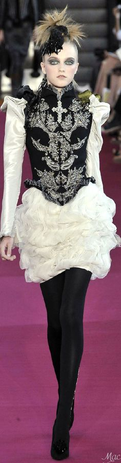 the white ruffles are poop. focus on the embroidery. I picture this as Lucia's slight feminization of the male fashion