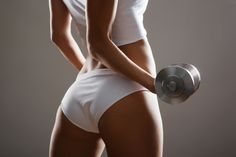 The 5 Best Gym Exercises For A Strong, Sexy Butt: barbell bench butt raise, dumbbell curtsy lunge, sumo dead lift (kettle bell), one-leg bridge, twisted walking lunges with weight