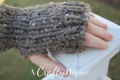 Beginner Knit Handwarmers. Use some matching colours for extra interest. Great for using up all those bits of left over chunky yarn| AllFreeKnitting.com