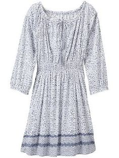 Printed Calico Tunic - The lightweight crinkle gauze tunic with a smocked front and tie back for a contoured fit.