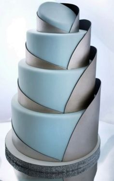 Geometric patterns are gaining more and more popularity today as they look modern and still unusual and creative. If you are planning to include geometric motifs into your wedding decor, we strongly recommend you to buy a geometric cake.