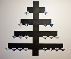 """Flat Wall Tree: This simple, paper, """"Charlie Brown"""" christmas tree was made with square, black, paper envelopes and old calendars. Christmas Crafts, Christmas Decorations, Xmas, Charlie Brown Christmas Tree, Diy Origami, Paper Envelopes, Tree Wall, Diy Tutorial, Diy Crafts"""