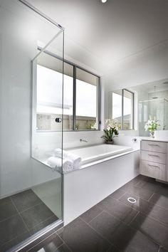 salle de bain gris et blanc et cabine de douche en verre