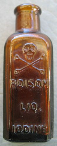 Labeled Skull Crossbones Amber Poison Bottle