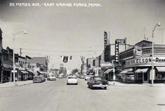 East Grand Forks, MN in 1958  You can see some of my Grandpa's neon signs still hanging.