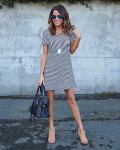 A must have for every stripe loving doll, a black and white striped dress. This dress is everything we have been searching for. Layer with a plaid, a denim jacket, a sweater or vest. The styling possibilities are endless with this go-to tshirt dress. We love everything about it and know you will too.