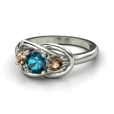 I NEED THIS. My 2 favorite colors in one! :) Round London Blue Topaz Sterling Silver Ring with Smoky Quartz - Eda Ring | Gemvara