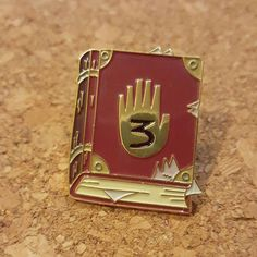 1.5 inch hard enamel pin featuring the all important Journal 3 from Gravity Falls.  Dont let Bill get his hands on this before you do.