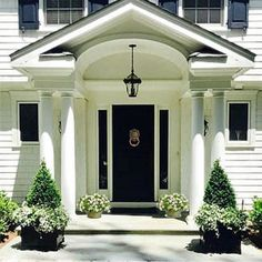 Love receiving pictures from my happy customers showing me how they are using their Provence planters- this classic beauty does The Enchanted Home proud!!😀 #provenceplanters#boxwoods#classiccolonial#happycustomers#blackdoor#enchantedhomeshop
