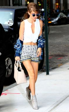 Gigi Hadid accessorising like a champ in the East Village in NYC. Those tassel shorts and blue sunglasses!: