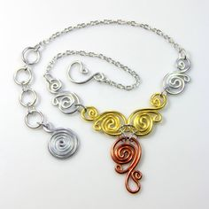 This necklace is made out of all anodized aluminum in a variety of metal colors. Anodized aluminum is non tarnishing, hypo allergenic and very light
