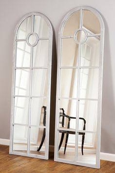 """Statements by J Rosen Grey Floor Mirror Add dimension to your home with this elegant floor mirror. - 10 individual square mirror panels - 1 circular mirror near the top - Sold individually - Color: grey - Approx. 71"""" H x 24"""" W x 1.5"""" D $360.00"""