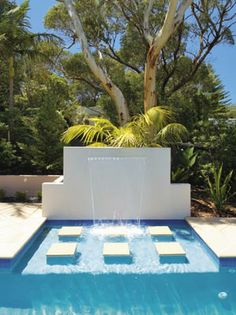 Add a water feature to your backyard to get that luxury resort feel!