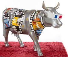 'Moo-vie Buff' created by Jennifer Ambrose;  CowParade in Raleigh, North Carolina  (2012)