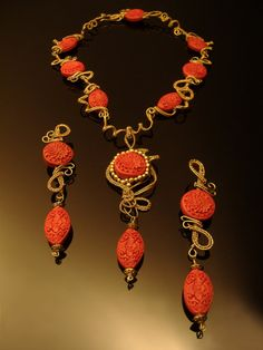 Woven wire cinnabar necklace and earrings by DahyiitihiArts