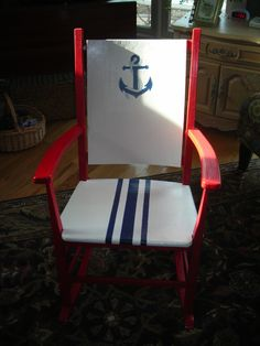 This rocker is part of a nautical themed custom bedroom set I did for a client.  The rocker was made by her grandfather.  I hand painted the anchor on the back rest.