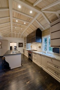 Kitchen Tray Ceiling. Tray ceiling with tongue and groove. Dramatic kitchen ceiling design. The #trayceiling includes a combination of stained #tongueandgroove and painted #beams. Fantastic #kitchen #ceiling #trayceiling Built by Andrew Roby General Contractor.