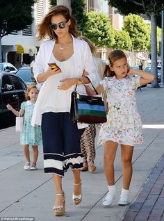 Mini mes: Her daughters Honor, seven, and haven, four, were impeccable matched in a pair of adorable summer dresses