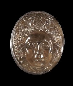 Large cameo of smoky quartz showing the head of Gorgo Medua showing subtle eerie features. In ancient silver mounting. Late hellenistic - Early Roman Imperial Period, 2nd century B.C. - 1st century A.D.