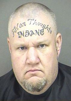Bad Tattoo the worst tattoos ever preserved forever in a jail house mugshot. Failed tattoos that make criminals look like they deserve jail.