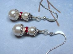 The snow girl earrings are made with white Swarovski crystal pearl beads, sterling silver over brass filigree bead caps for her skirts, fuchsia Swar. Girls Earrings, Bead Earrings, Christmas Earrings, Beaded Jewelry Patterns, Homemade Jewelry, Christmas Jewelry, Jewelry Crafts, Beaded Crafts, Snow Girl