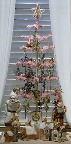 Rare pink feather Christmas tree with Czechoslovakian beaded glass ornaments.