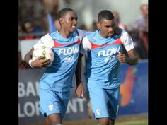 St George's College's Dominic James (left) celebrating his goal with Gregory…