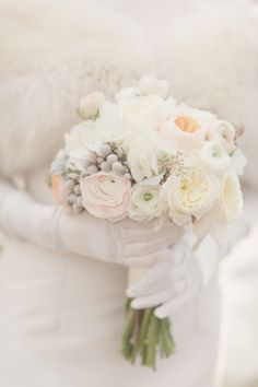winter white bouquet with wedding gloves