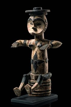 Africa | Sitting puppet figure from the Eket people of Nigeria | Wood, originally dyed with kaolin, accents in black paint