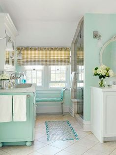 Refresh your bathroom with a sea-inspired color palette! See the rest of this space: http://www.bhg.com/bathroom/decorating/cottage/beachy-cottage-bathroom-makeover/?socsrc=bhgpin092113seainpired&page=1