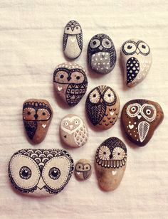 Hand painted rock owls: paint with black and white acrylic ink and seal with a matte varnish to provide protection from the elements.