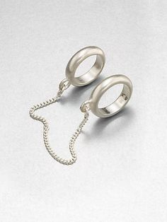 Maison Martin Margiela's silver linked rings will give your outfit a new element of danger. #15Things #fashion #style #trending #accessories #jewelry #rings #MaisonMartinMargiela #silver #linkedrings