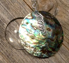 A personal favorite from my Etsy shop https://www.etsy.com/listing/497173869/magnifying-glass-necklace-with-abalone