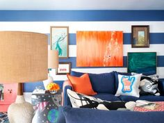 Bring a personal touch to your living room with pillows showcasing your child's artwork. Here, the homeowners scanned the artwork, uploaded it to a digital printing company, then had their little one's masterpiece printed onto canvas and stitched into pillows. Check out online sites, like Shutterfly, to create your own photo-based decor.