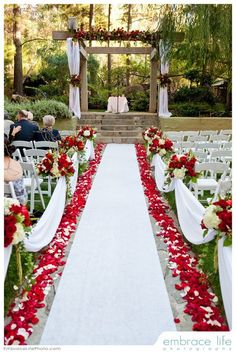 Red and white wedding ceremony flowers / http://www.deerpearlflowers.com/fall-red-wedding-ideas/