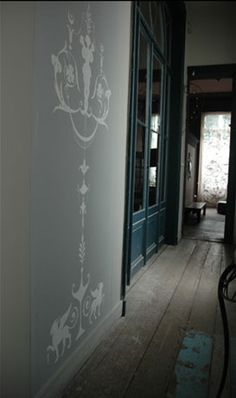 conservatory. Wall art, neat idea for the residence side of the building
