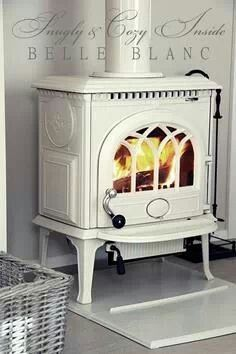 What a wonderfully lovely, timeless wood stove done up in fresh, versatile white. FOR ALL SEASON ROOM Decor, Wood, House, Home, Vintage House, Small Stove, New Homes, Stove, Wood Stove Fireplace