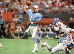 Warren Moon, Houston Oilers who had to go to the CFL and then come back to the NFL to set records but as we know he was judged on lack of championships, but he is in the HOF