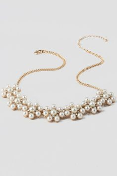 """The Spencer Pearl Statement Necklace adds a touch of simple class to any outfit. Pearl clusters are accented by crystal rhinestones in flower shapes on a gold chain. Wear with a fancy top and pearl earrings for your Holiday look!<br />%0D%0A<br />%0D%0A- Finished with a lobster claw clasp<br />%0D%0A- 17.5"""" length<br />%0D%0A- 3.5"""" extension<br />%0D%0A- Lead & nickel free<br />%0D%0A- Imported"""