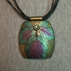 Polymer clay leaf imprint pendant